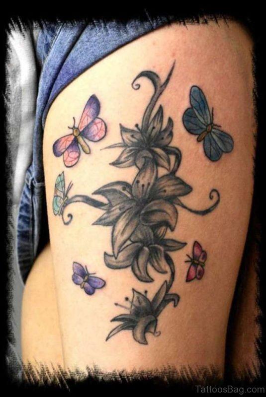 Lilies Butterfly Tattoo