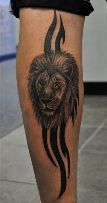 Lion Face And Tribal Tattoo