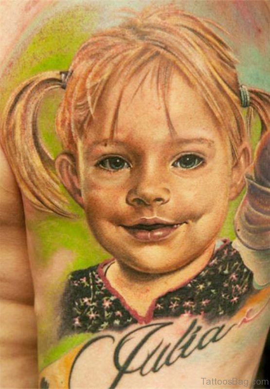 Little Girl Portrait Tattoo On Bicep