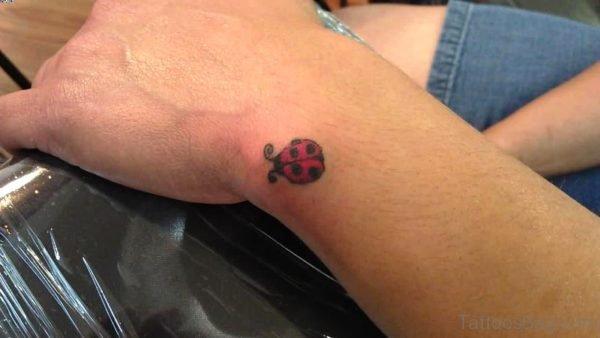 Little Red Ladybug Tattoo On Wrist
