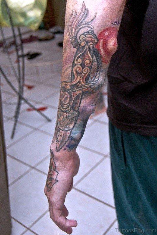 Long Dagger Tattoo On Arm