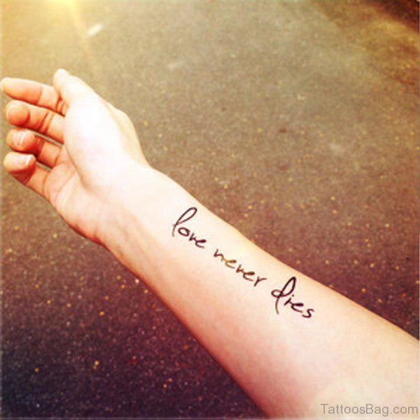 Love Never Dies Tattoo On Wrist