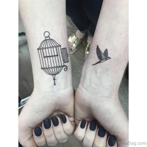 Lovely Bird And Cage Wrist Tattoo