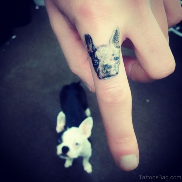 Lovely Dog Tattoo On First Finger