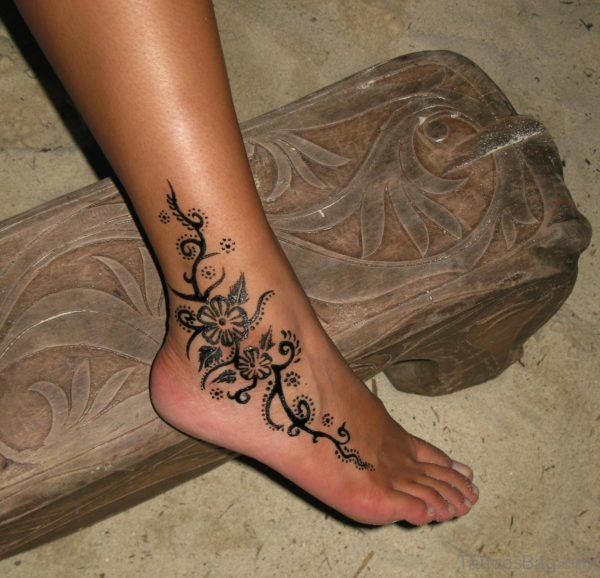 Lovely Drawing Tattoo On Ankle
