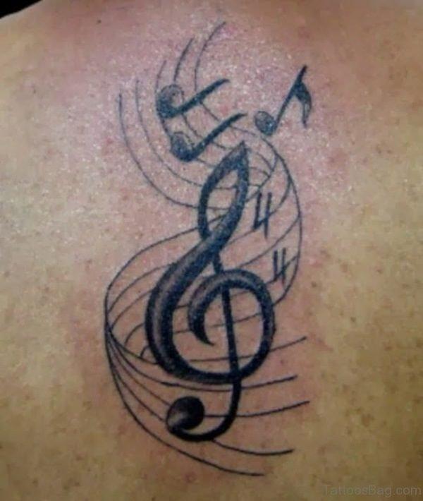 Lovely Music Tattoo On Shoulder Back