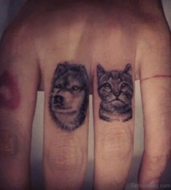 Lovely Dog And Cat Tattoo On Finger