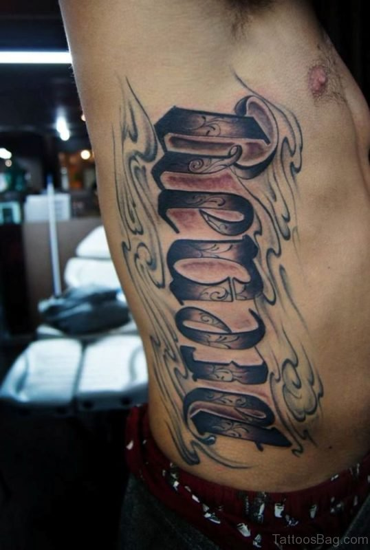 Magnificent Ambigram Tattoo On Rib