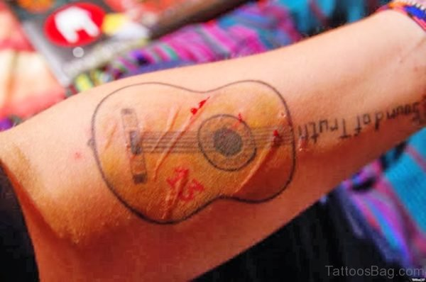 Magnificent Guitar Tattoo On Forearm