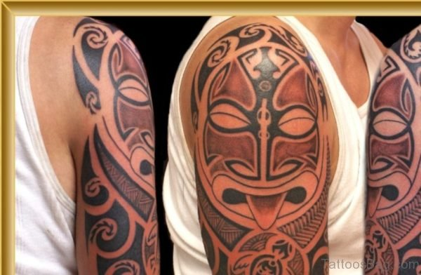 Maori Mask Tattoo On Shoulder