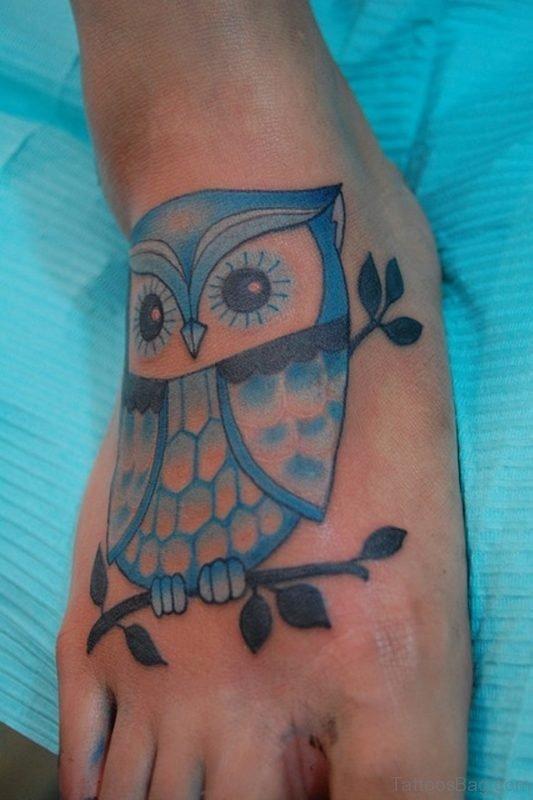 Marvelous Blue Owl Tattoo On Foot
