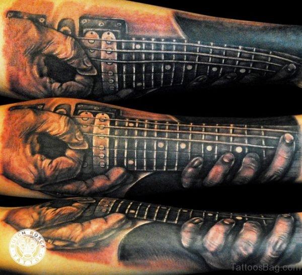 Marvelous Guitar Tattoo On Forearm