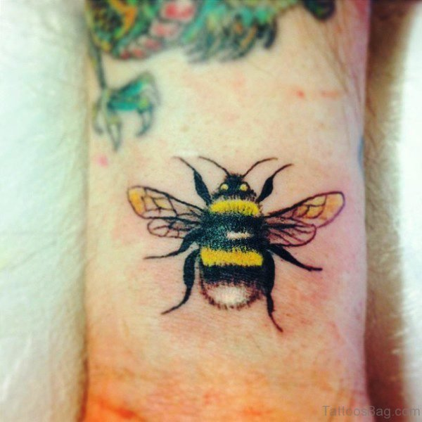 Marvelous Yellow Bee Tattoo On Wrist