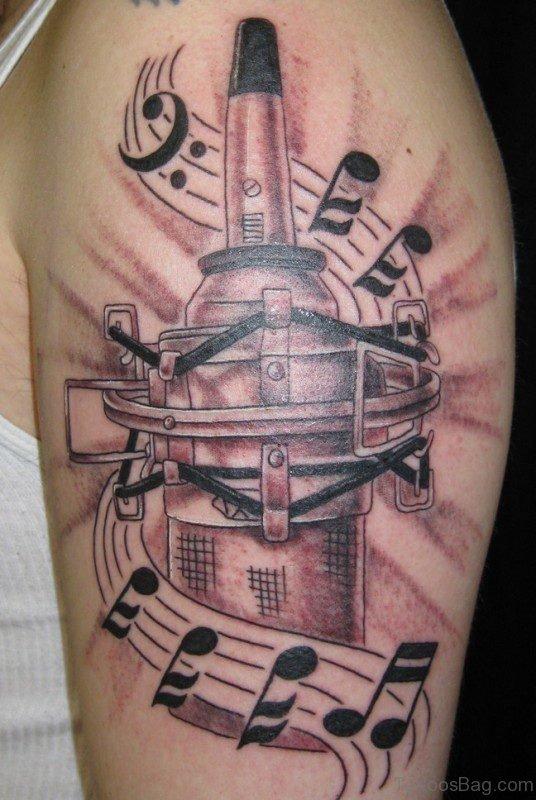 Massive Music Tattoo On Shoulder