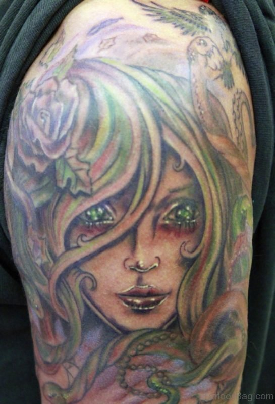 Medusa With Green Eyes Tattoo For Shoulder
