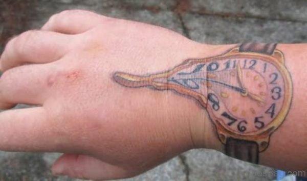 Melting Clock Tattoo On Wrist
