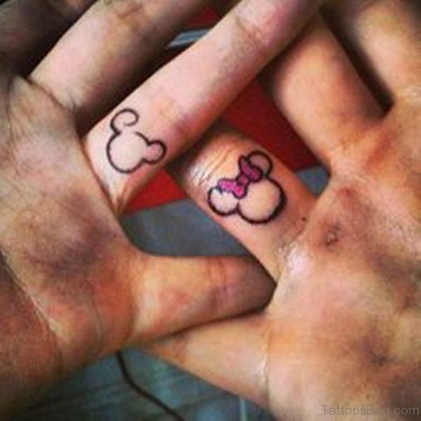 Minnie Mickey Tattoo On Fingers