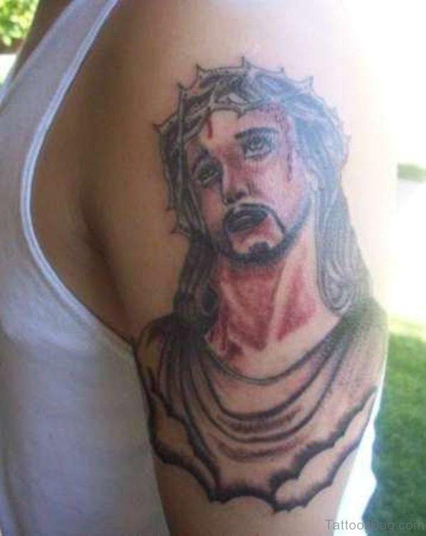 Morose Jesus Tattoo On Shoulder