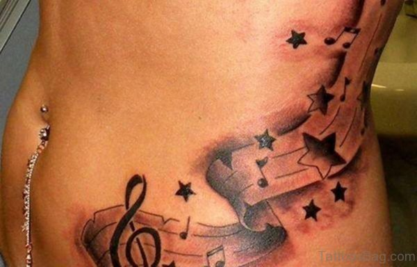 Music And Stars Tattoo On Rib