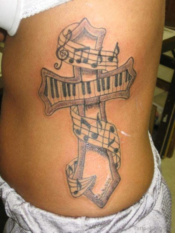 Music Notes And Cross Tattoo