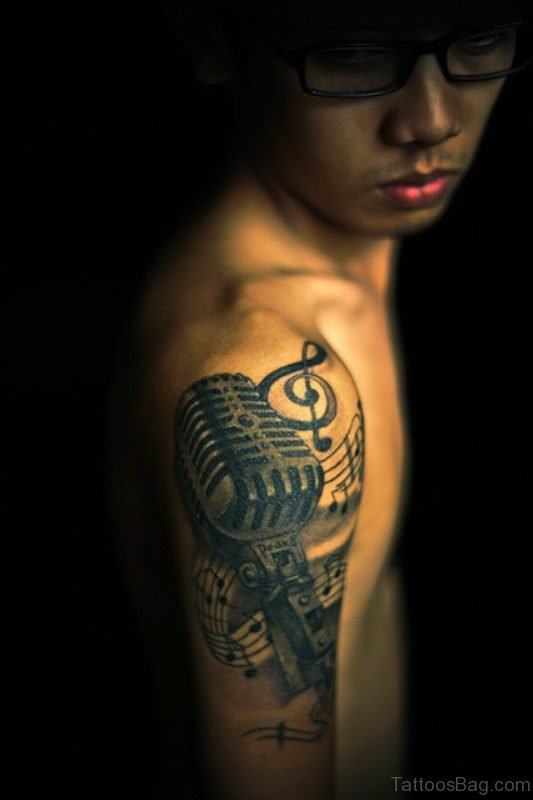 Music Tattoo On Right Shoulder