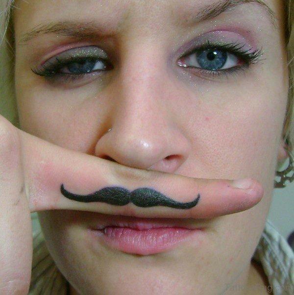 Mustache Tattoo On Finger