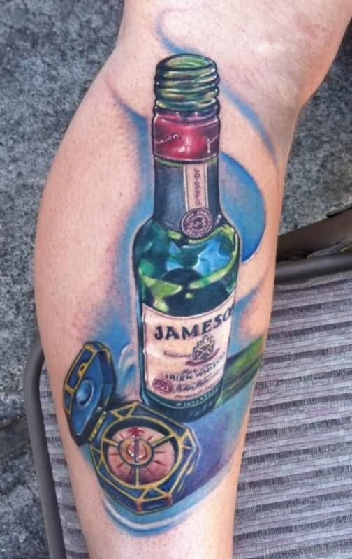 Nautical Compass And Bottle Tattoo On Leg