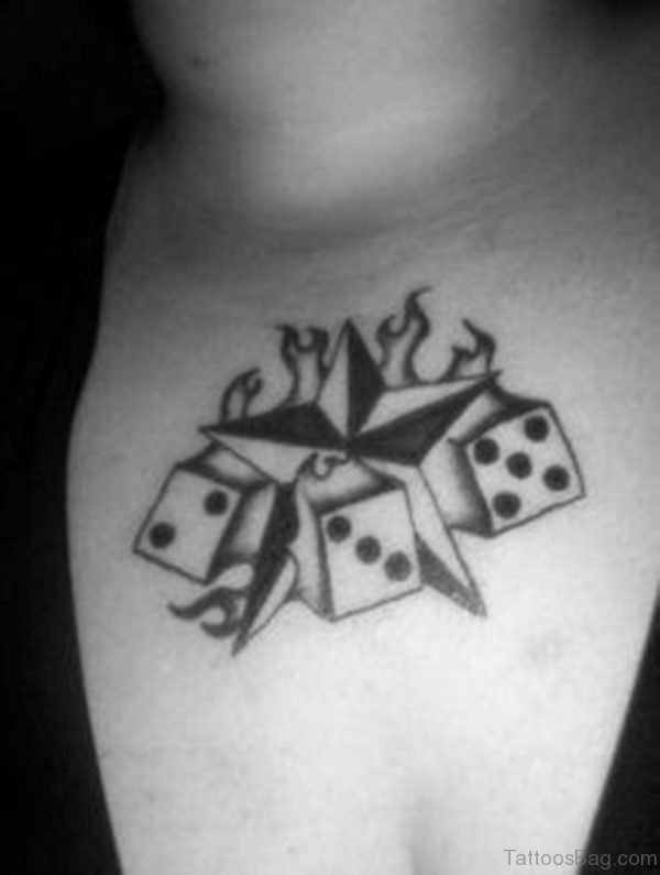 Nautical Star And Dice Tattoo On Chest