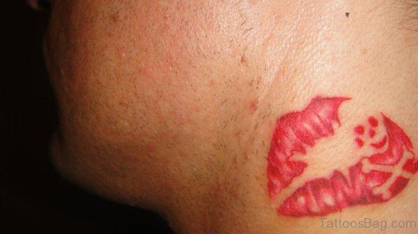 Neck red Kiss Mark tattoo