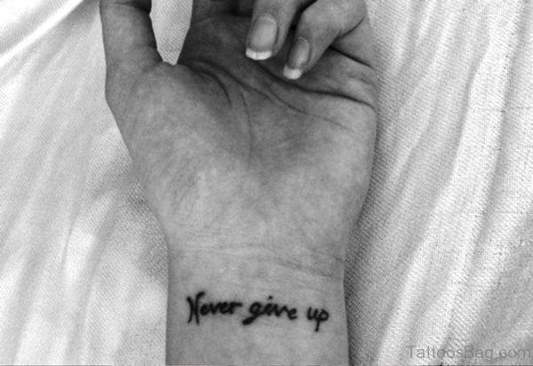 Never Give Up Wrist Tattoo