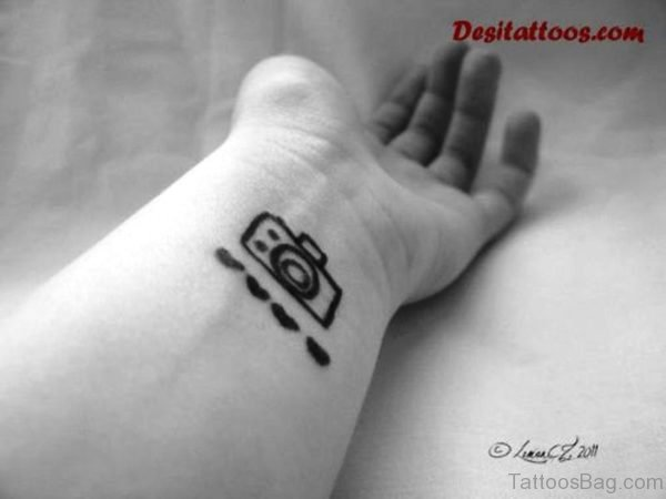 Nice Black And White Camera Wrist Tattoo
