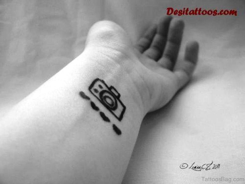 2af8d46142d82 Nice Black And White Camera Wrist Tattoo
