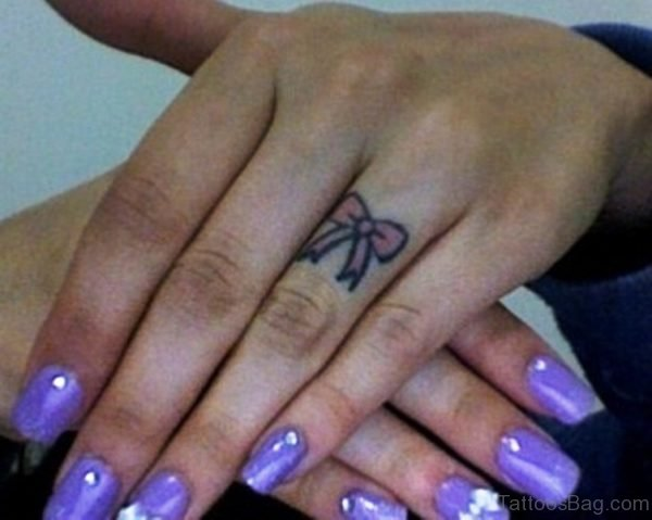Nice Bow Finger Tattoo