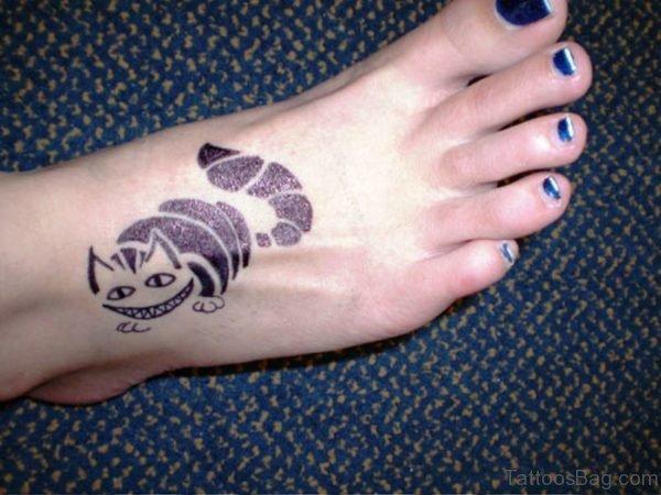 Nice Cheshie Cat Tattoo On Foot