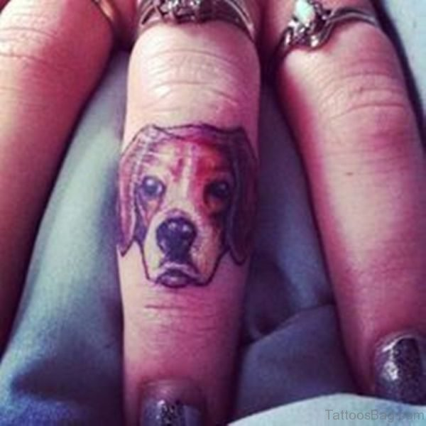 Nice Dog Face Tattoo On Middle Finger