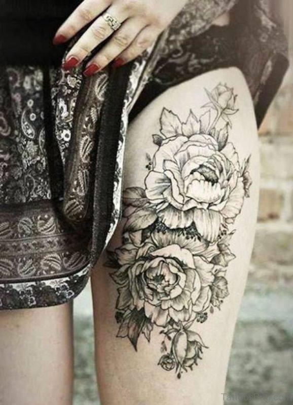 Nice Flower Tattoo On Thigh
