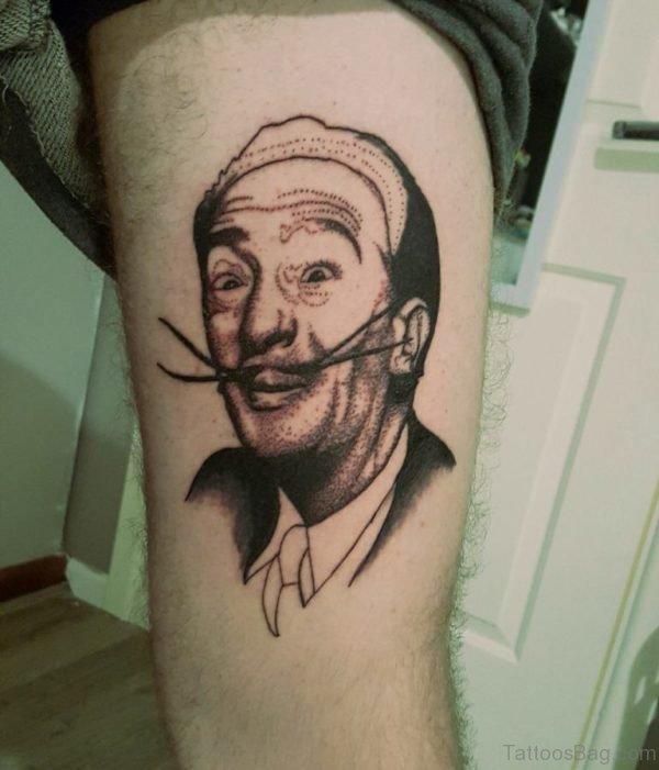Nice Funny Portrait Tattoo On Thigh