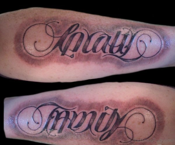 Nice Greed Ambigram Tattoo On Arm