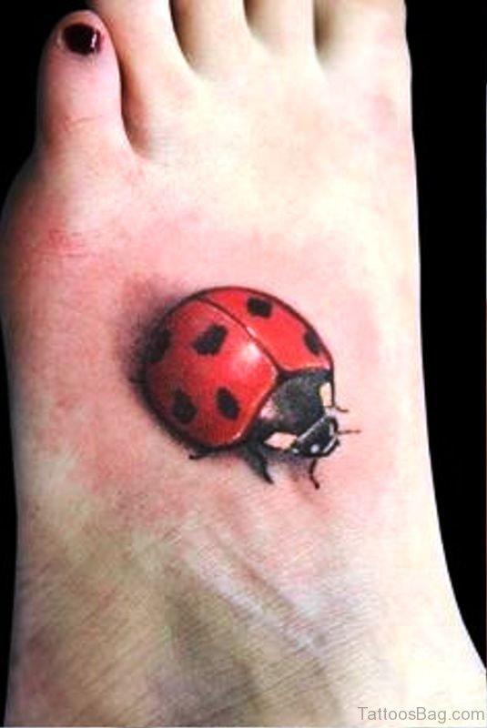Nice Ladybug Tattoo On Foot