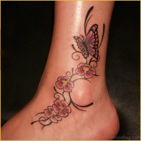 Nice Looking Flowers With Butterfly Tattoo