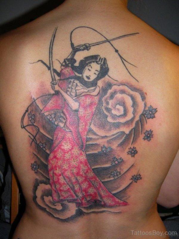 Nice Looking Geisha Tattoo On Back