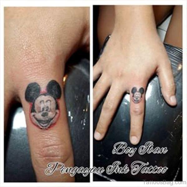 Nice Mickey Face Tattoo On Finger