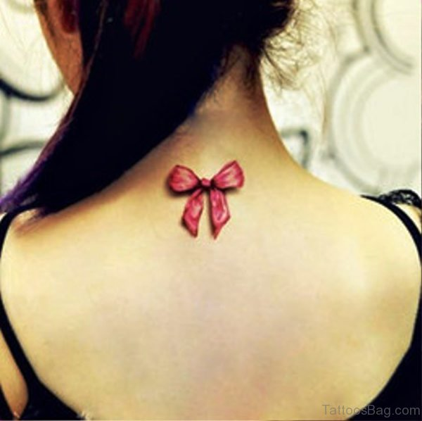 Nice Pink Bow Tattoo On Neck