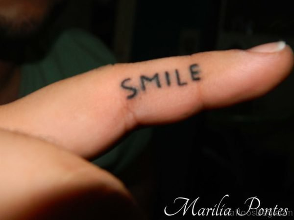 Nice Smile Tattoo Design On Finger