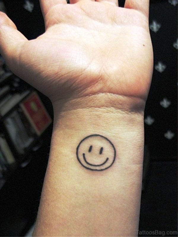 Nice Smiley Tattoo On Wrist