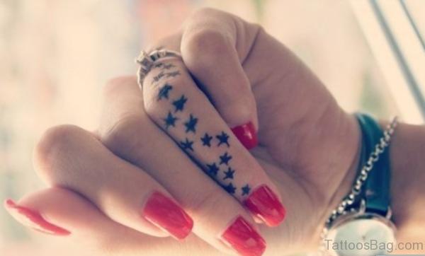 Nice Star Tattoo On Finger