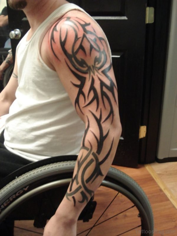 Nice Tribal Design Tattoo On Left Full Sleeve For Men
