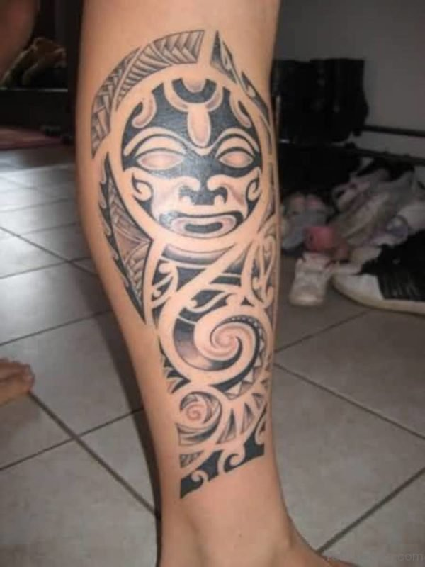 Nice Tribal Mask Leg Tattoo Design For Men
