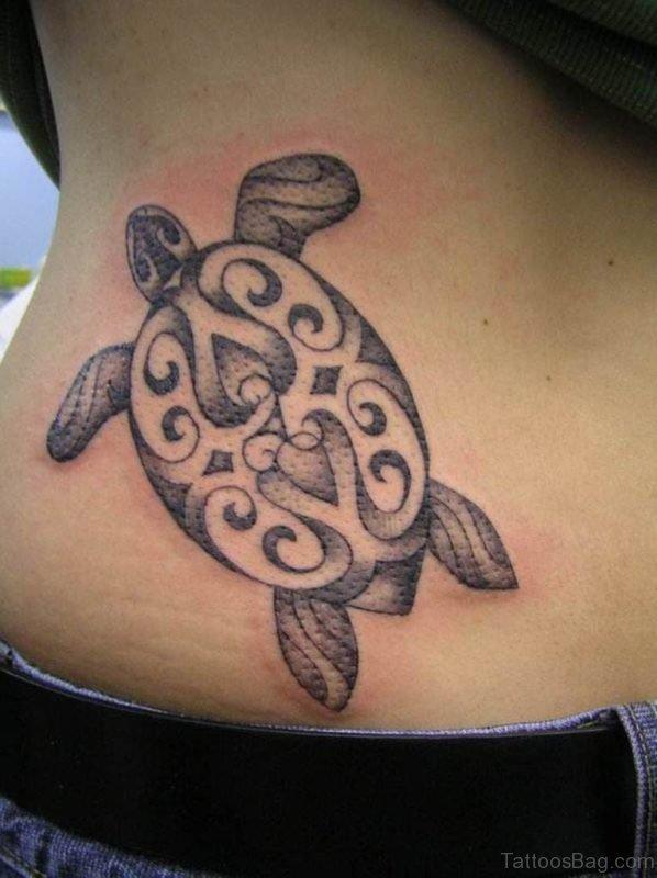 Nice Turtle Tribal Tattoo On Side Rib For Women