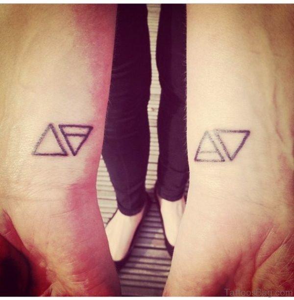 Nice Two Triangle Tattoo On Wrist